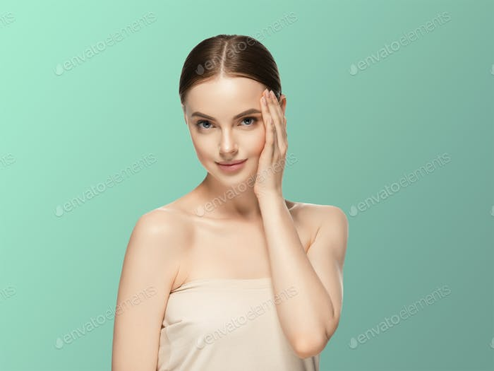 Woman face beauty hand touching   healthy skin natural makeup beautiful female blue background