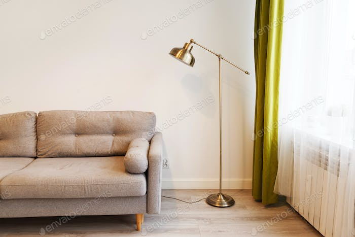 Modern apartment with sofa and a lamp