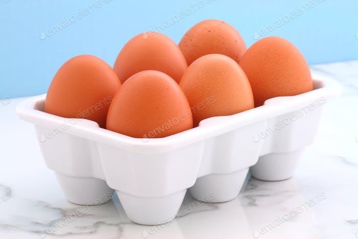 Fresh eggs on kitchen station