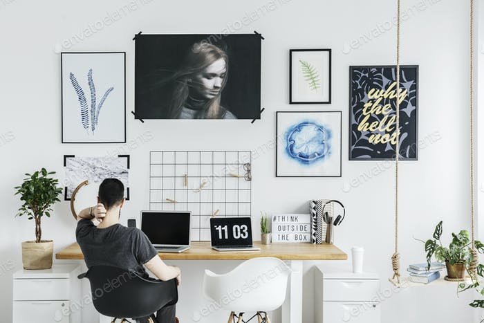 Man in white home office