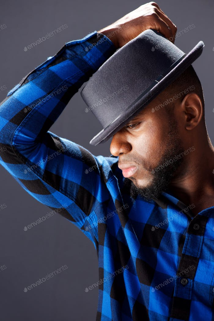 side portrait of trendy handsome man with hat