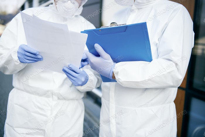 Close up of two technicians with documents