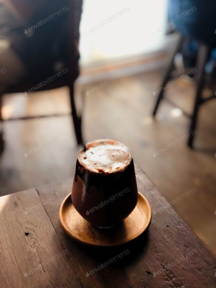 close up modern hot black chocolate in cup looking and feel so delicious on woodenr table in coffee
