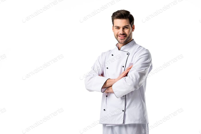 portrait of smiling chef in uniform with arms crossed isolated on white