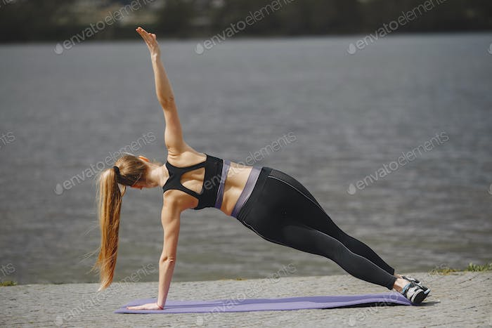 Sports girl training in a summer park