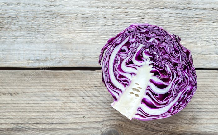 Red cabbage on the wooden background