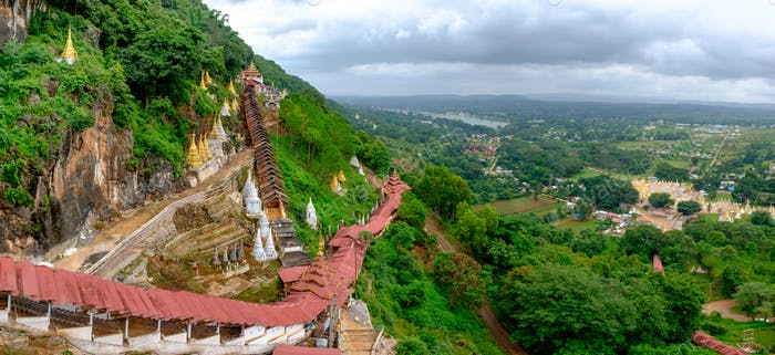 Colorful red staircase roofs and beautiful landscape at Pindaya caves, Myanmar