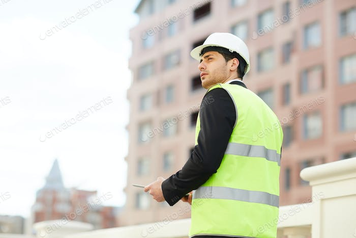 Back view of construction manager
