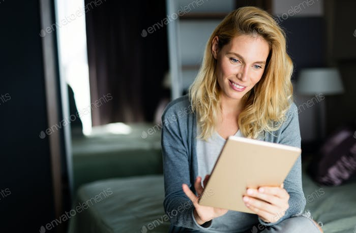 Portrait of attractive woman in hotel room