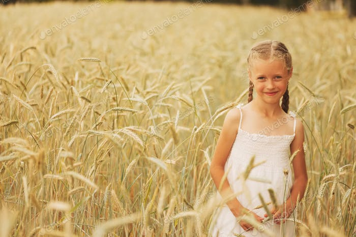 young girl in the yellow field