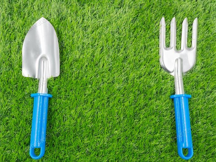 garden tools on grass background.