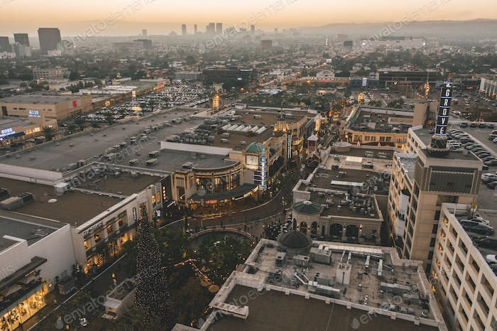 The Grove Shopping Center in Los Angeles at Sunset with Shops and Hollywood Skyline in the distance
