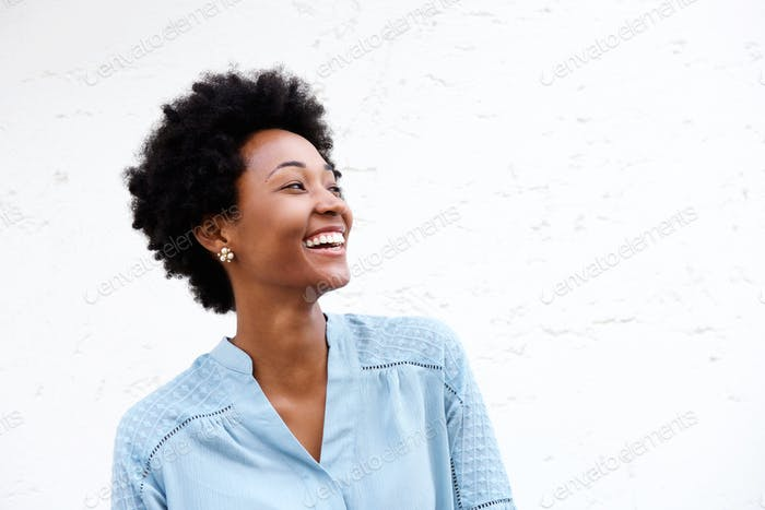 Beautiful young black woman looking away and smiling