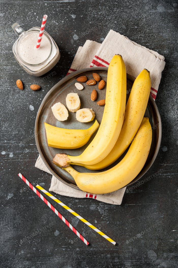 Banana smoothie  and bananas on a plate