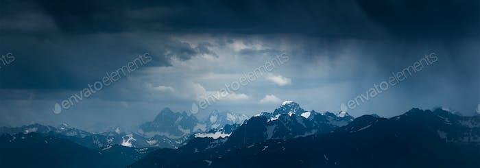 Mountain landscape before storm. Mounts Sofiya and Karakaya. Caucasus Mountains.
