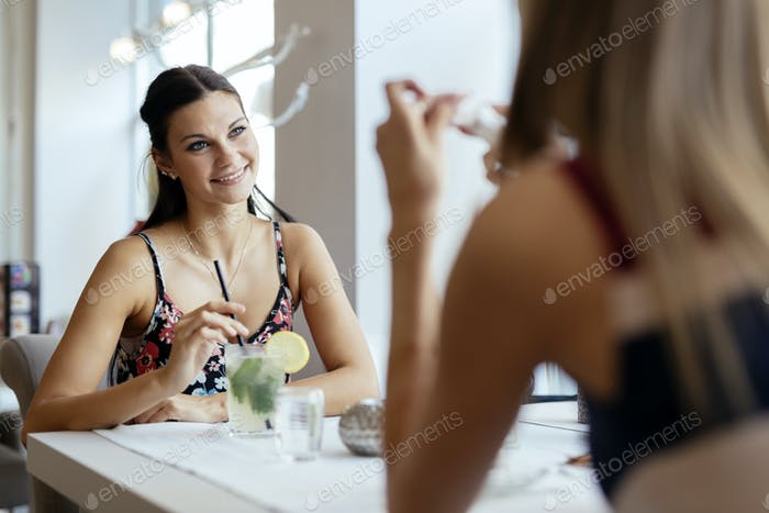 Women talking in restaurant