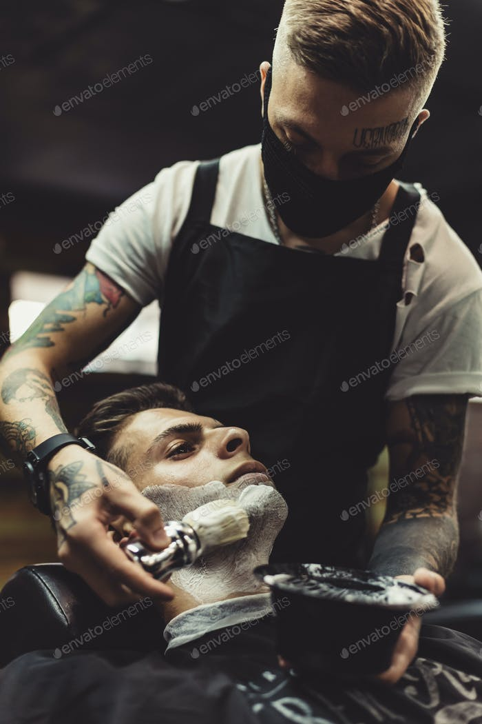 Barber shaving client