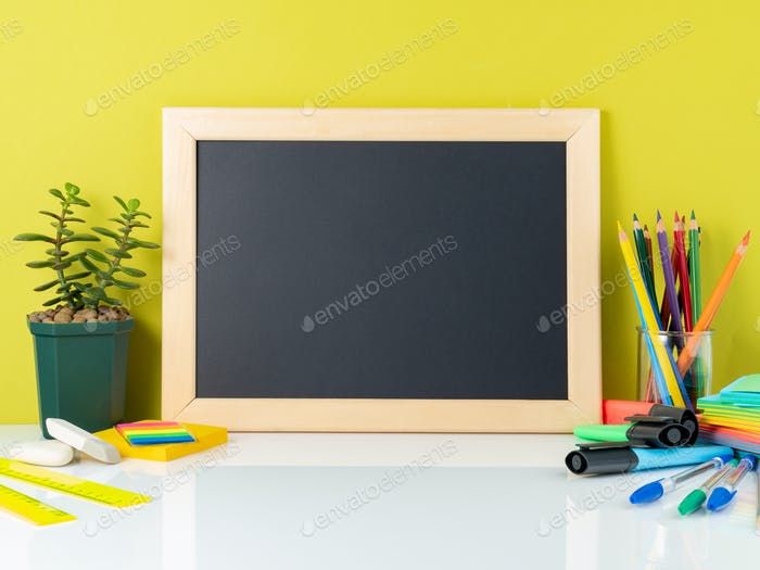 Chalkboard, succulent and school supplies