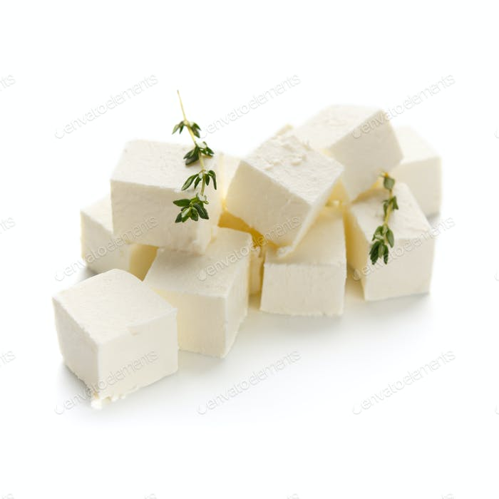 Feta cheese cubes on white