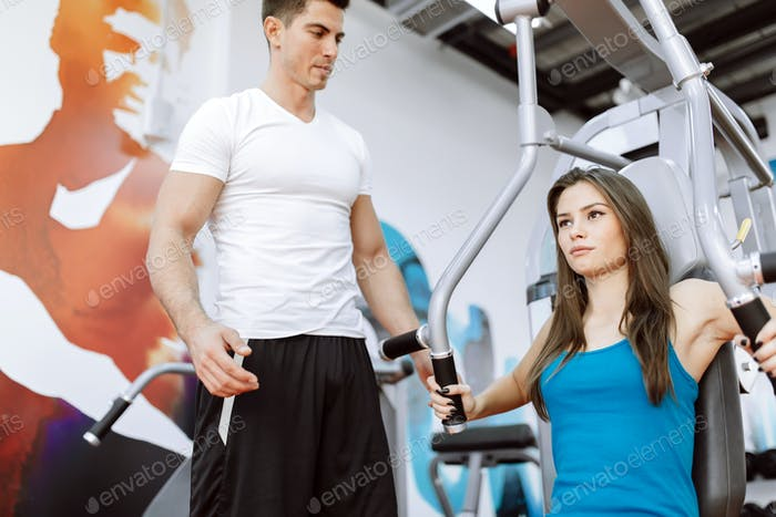 Thumbnail for Beautiful woman exercising in gym