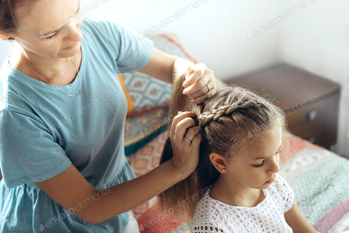Mother and daughter, hair braid