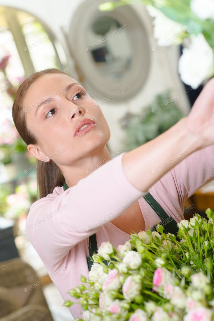 Florist reaching up