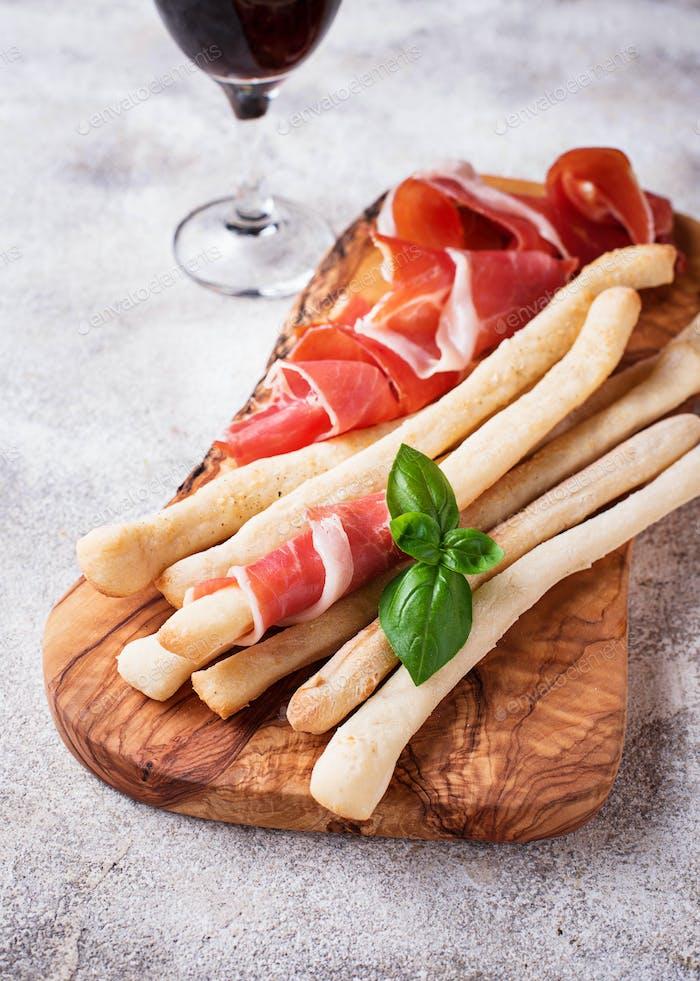 Traditional Italian antipasto grissini and prosciutto