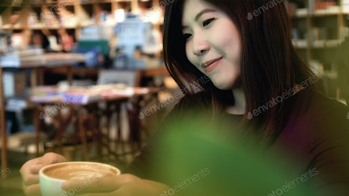 Portrait of asian businesswoman in casual suit drinking in happiness action