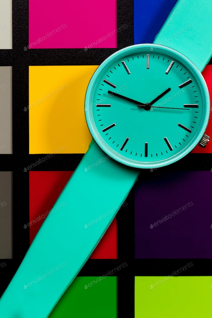 Clock on a  colored background. Abstraction. Minimalism