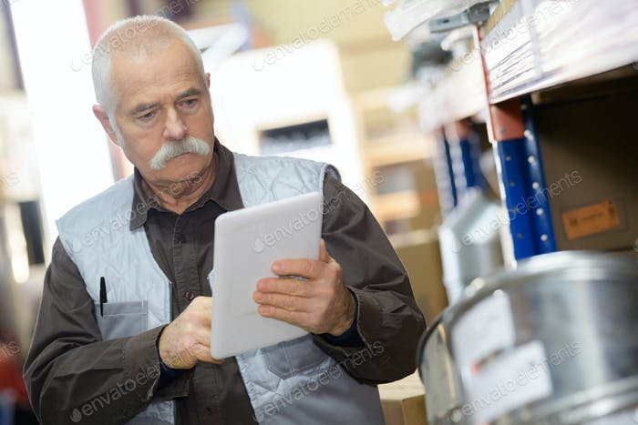 Senior man using tablet at work