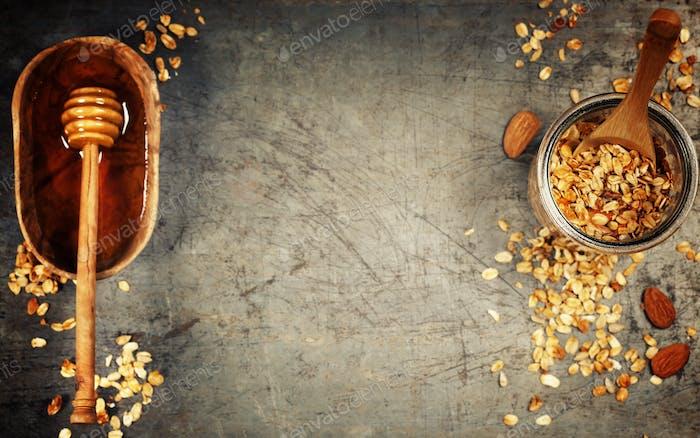 Healthy homemade granola and honey. Granola