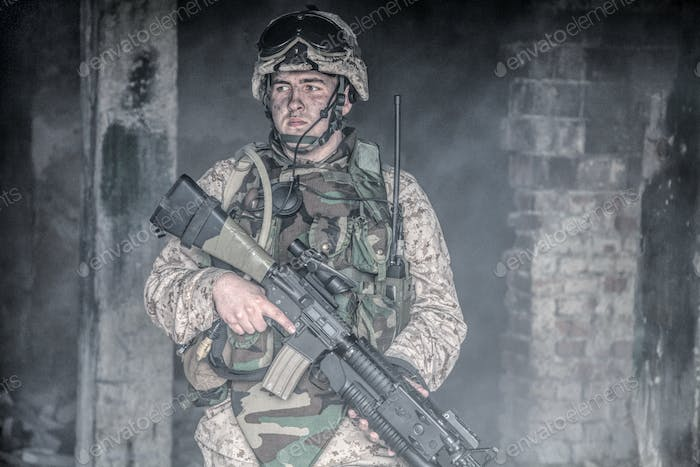 Equipped marine in combat conditions in war zone