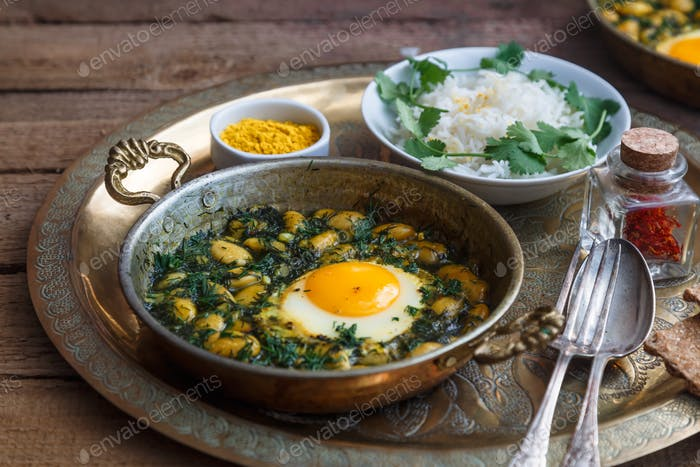 Iranian breakfast made with eggs, bean and dill