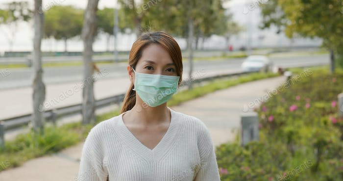 Woman wearing medical face mask street