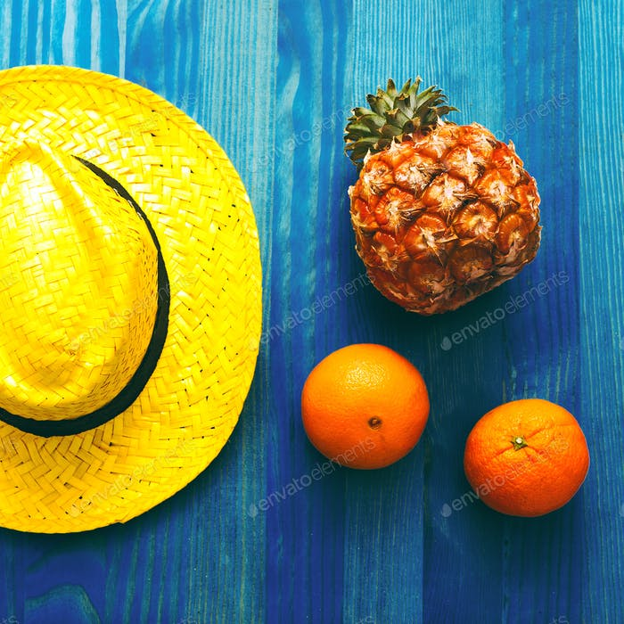 Fruit and straw hat. Beach cocktail. Tropical Minimal. Fresh ide