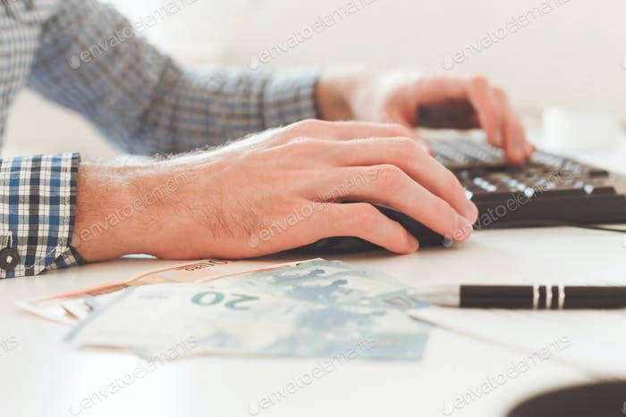 Office work. Businessman work on computer with finances. Blurred background, film effect