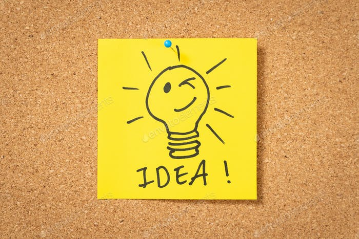 yellow sticker note with lightbulb and idea message