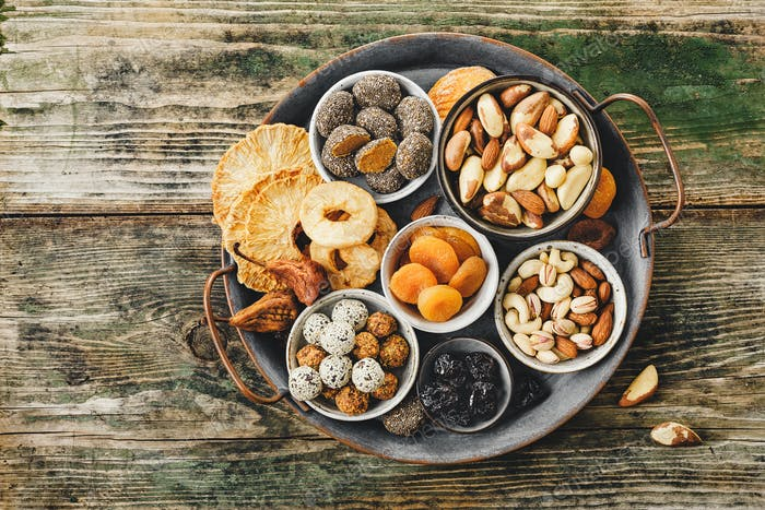 Mix of nuts and dried fruits on a old metal tray