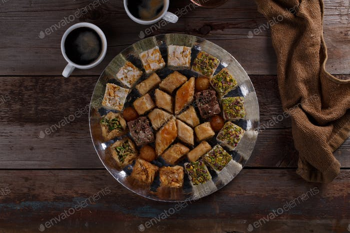 Oriental Dessert Baklava with coffee on silver tray, copy space