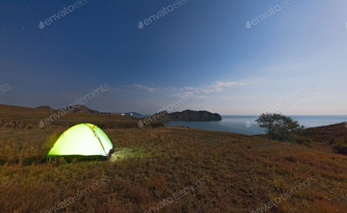 Tourist tent on a promontory near the sea