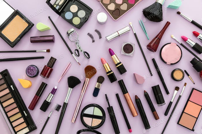 Make up cosmetics products against pastel purple background,