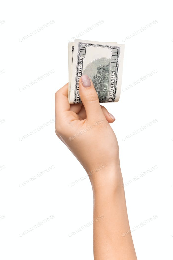 Wise savings. Female hand holding pile of dollars