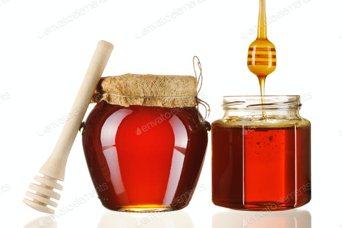 Jars of honey and dipper
