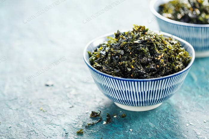 Healthy Japanese bowl of seaweed with sesame and sea salt.