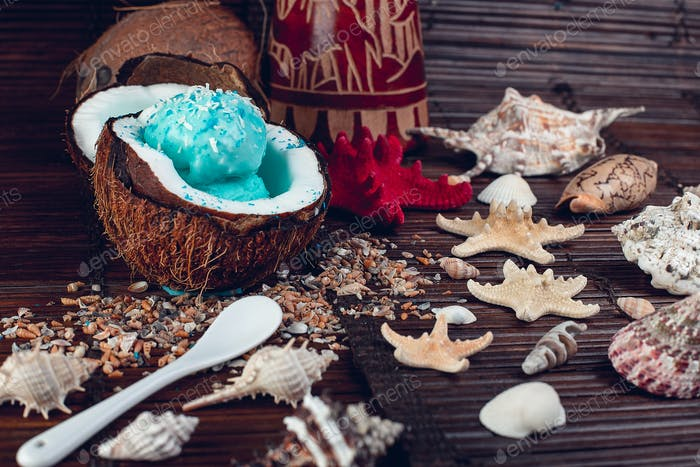 Blue ice cream in coconut bowl. Summer vacation