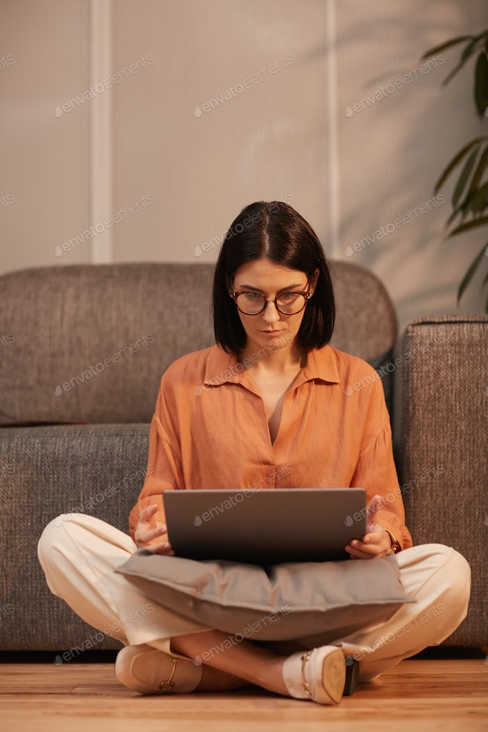 Businesswoman Sitting Cross-Legged with Laptop