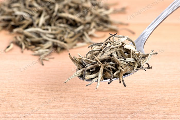 White Organic Needle Tea  on Cutting Board