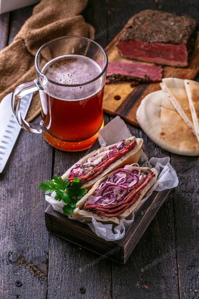 Pastrami with cabbage in pita bread with beer, rustic