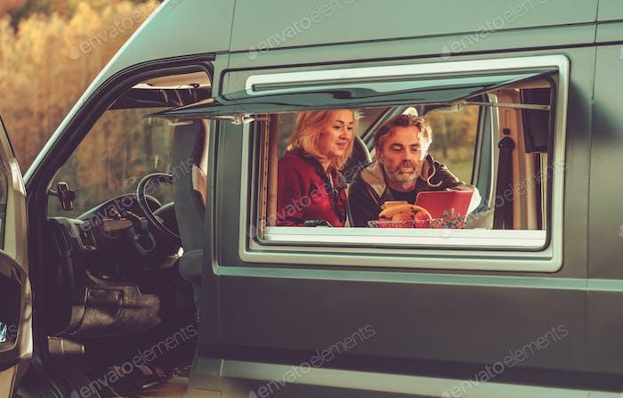 Couple Watching Movie Online Inside Their Camper Van