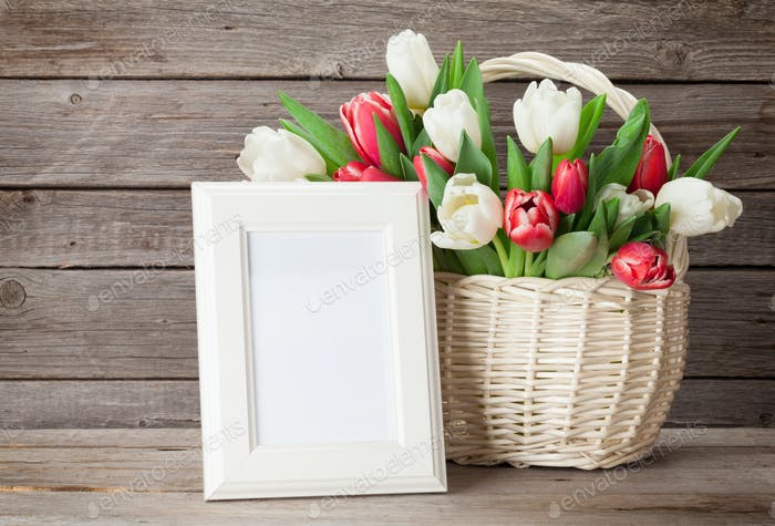 Colorful tulips bouquet and photo frame